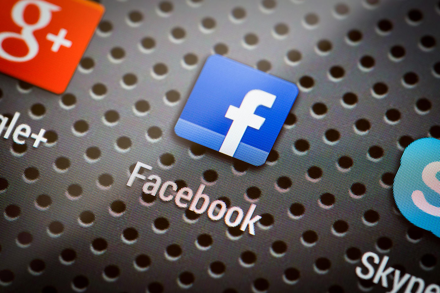 BELCHATOW, POLAND - APRIL 10, 2014: Closeup photo of Facebook icon on mobile phone screen. Popular social network.