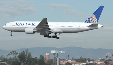 LOS ANGELES - JAN 15: A United Airlines 777 on approach to LAX on January 15, 2012 in Los Angeles.  The Boeing 777 is the larges