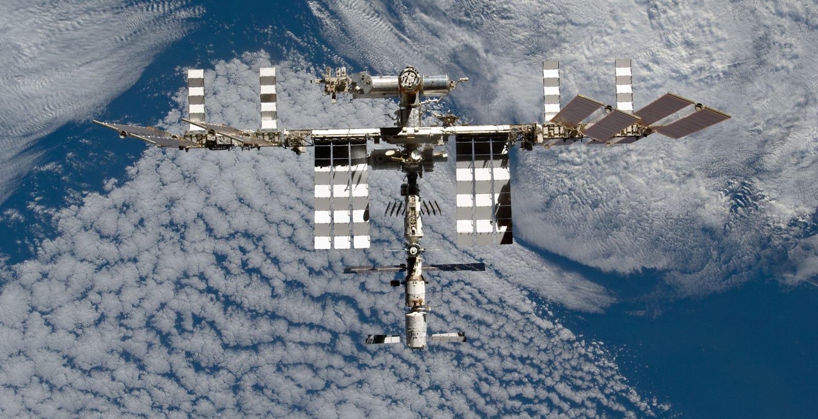 Space Station Over Earth (NASA, International Space Station, 03/07/11)