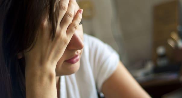 an image of girl with headache
