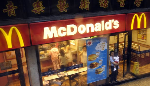 A woman and child walk out of a McDonald's restaurant in Hon