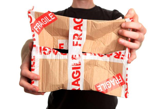 Man holding damaged parcel