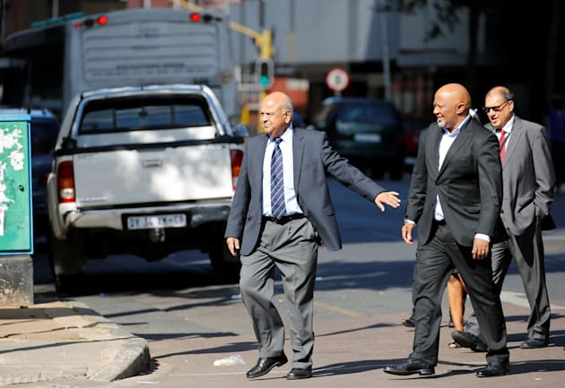 South Africa's Finance Minister Pravin Gordhan (L) gestures to his deputy, Mcebisi Jonas as they walk...