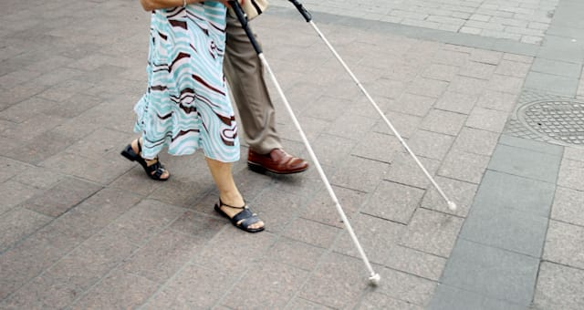 Blind people walking in the street