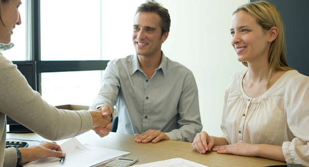 CCBM9F Couple shaking hands with businesswoman in office  client; businesswoman; business; relationship; handshake; client; coup
