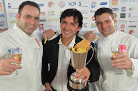 Handout photo of Stuart and Adrian Fusco of Quayside in Whitby, north Yorkshire, with with celebrity chef Jean Christophe Novelli after they were crowned the best UK fish and chip shop  in the National Fish and Chip Awards 2014 at a ceremony in central London.  PRESS ASSOCIATION Photo. Picture date: Wednesday January 22, 2014. See PA story CONSUMER Fish. Photo credit should read: Daniel Lewis/PA WireNOTE TO EDITORS: This handout photo may only be used in for editorial reporting purposes for the contemporaneous illustration of events, things or the people in the image or facts mentioned in the caption. Reuse of the picture may require further permission from the copyright holder.