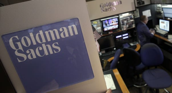 In this March 15, 2012 photo, a trader works in the Goldman Sachs booth on the floor of the New York Stock Exchange. Goldman Sachs more than doubled its first-quarter profits and announced plans to raise its dividend Tuesday, March 17, 2012.  The strong results masked other problems, including a 16 percent decline in revenue. To make up for that, and to propel earnings higher, Goldman turned to cost-cutting. (AP Photo/Richard Drew)