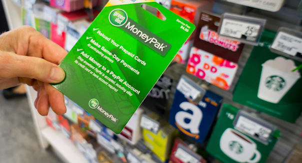A shopper chooses a Green Dot brand MoneyPak prepaid card in a store in New York