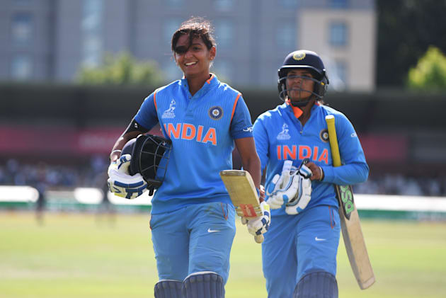 That's Harmanpreet on the left, looking satisfied with her day's work of humiliating Australia's