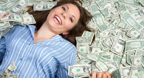 beautiful woman laying in money
