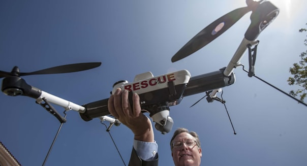 March 27, 2013 - Los Angeles, California (CA, USA - David Heidel of Aerovironment, shows their Qube drone. (Credit Image: © Rin