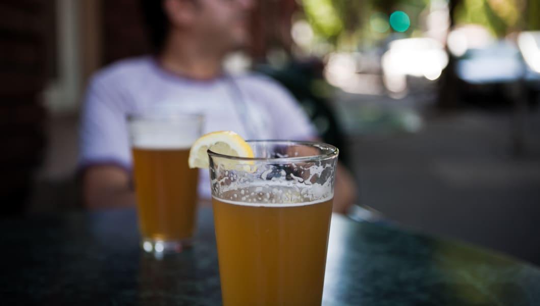Drinking beer in a sidewalk table