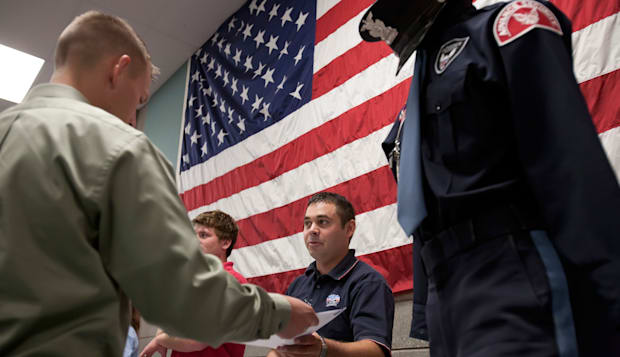 Grand Rapids, Michigan - Military veterans look for work at a job fair at the Army Reserve Center.