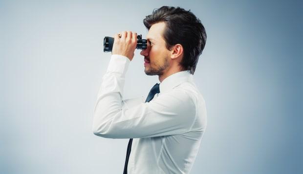 businessman with binocular copy ...
