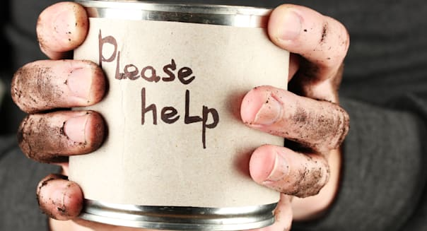 homeless man asks for help  on...