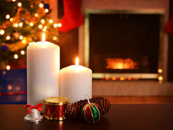 two christmas candles focus on...