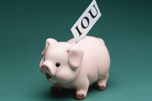 Piggy bank with IOU