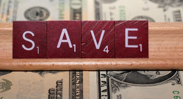 SAVE spelled out in Scrabble pieces