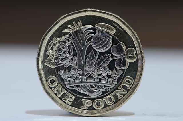 Tesco miss trolley deadline for new £1 coin