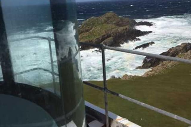 A  view of crashing waves from the lighthouse