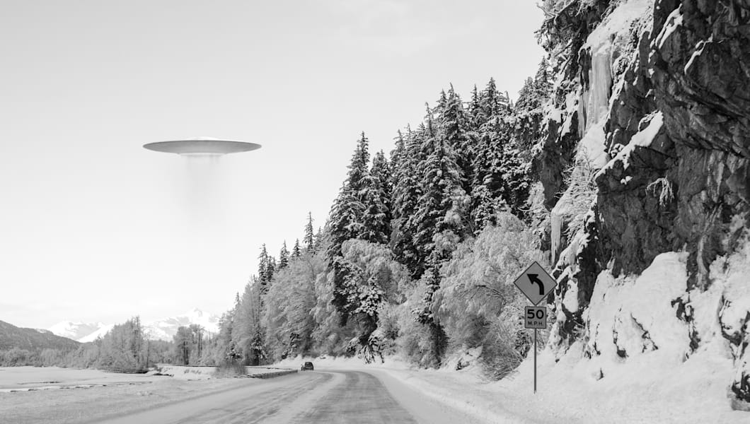 ufo space ship hovering over an ...