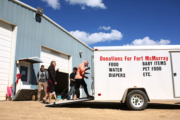 A truck with donations arrives at Wandering River, Alta. after raging forest fires forced more than 80,000...