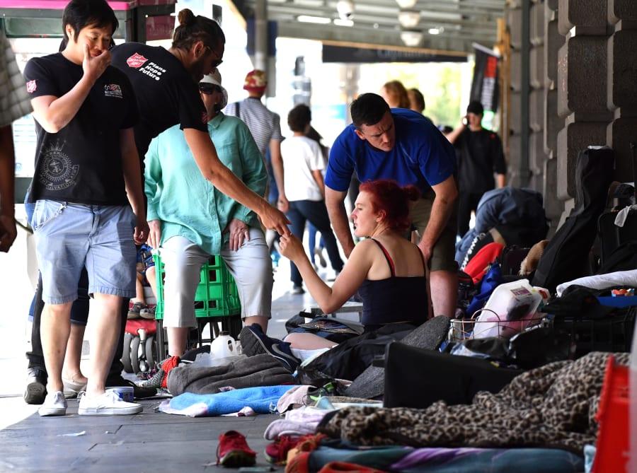 Homeless people camp along Flinders Street on January 18,