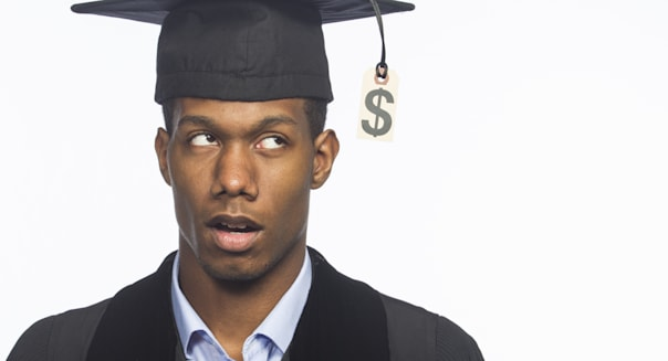 College graduate annoyed with tuition price tag, horizontal
