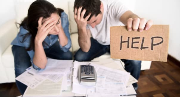 young couple in bad financial situation stress asking for help