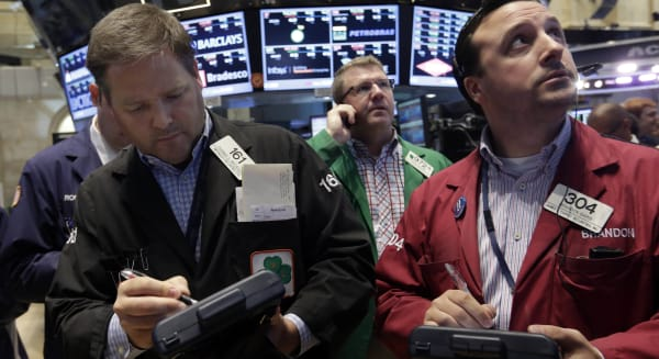 wall street new york stock exchange traders futures earnings economy
