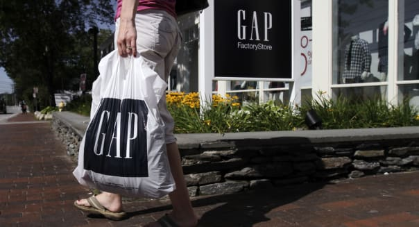 In this Wednesday, Aug. 17, 2011, file photo, a shopper leaves the Gap store in Freeport, Maine. Clothing retailer Gap Inc. said Thursday, Aug. 2, 2012,  that July sales at stores open at least a year jumped 10 percent, easily surpassing analysts' expectations, and said second-quarter earnings would rise from last year's results.   (AP Photo/Pat Wellenbach)
