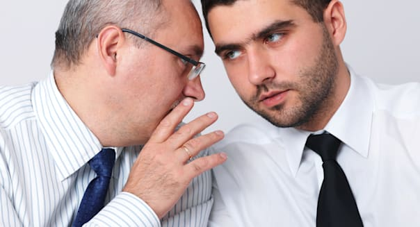 Mature businessman whisper something to his younger colleague, privacy, secret concept; Shutterstock ID 92241127; PO: CPA    adu