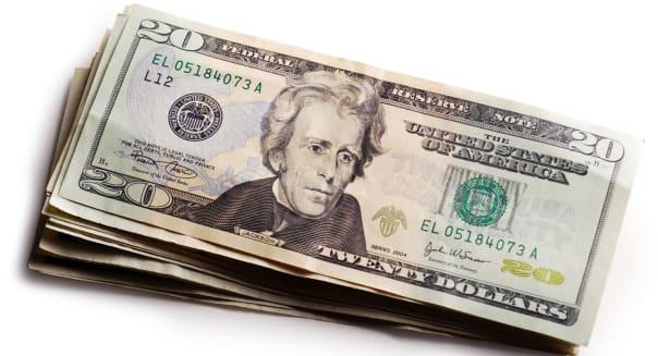 AYC7BB Stack of new US 20 dollar bills money cash