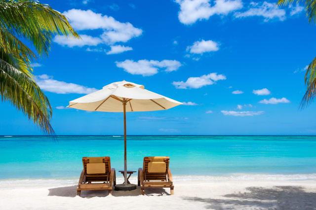 turquoise sea  deckchairs ...