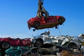 Crane picking up a car in a junkyard.accident, aluminum, car, center, compressed, crane, crushed, destroy, dump, ecology, engine