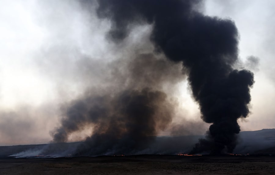 Smoke billows from a burning oil well, set ablaze by retreating Islamic State (IS) group's jihadists,...
