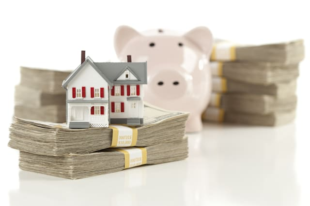 small house and piggy bank with ...