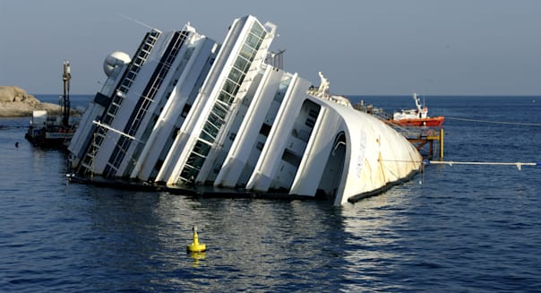 Costa Concordia lying on its side next to Giglio Island, Tuscan Archipelago, Italy - PREPARATIONS FOR ITS REMOVAL