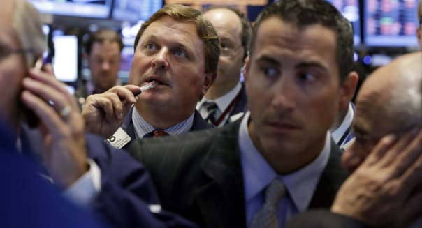 new york stock exchange traders wall street investing syria energy
