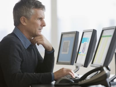 Businessman typing on computer