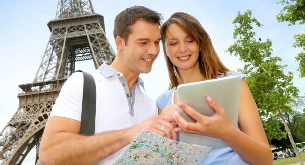 tourists using electronic...