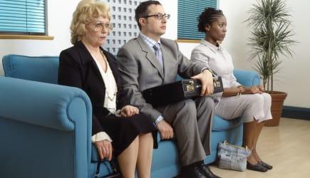 Three people waiting on sofa