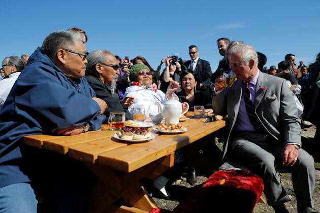 Britain's Prince Charles drinks tea during a tour of Sylvia Grinnell Park in Iqaluit, Nunavut, Canada,...