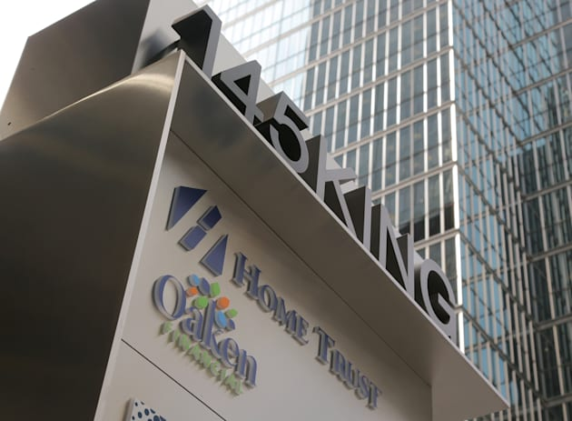 A sign shows the logos of Home Capital Group's subsidiaries Home Trust and Oaken Financial in front of...