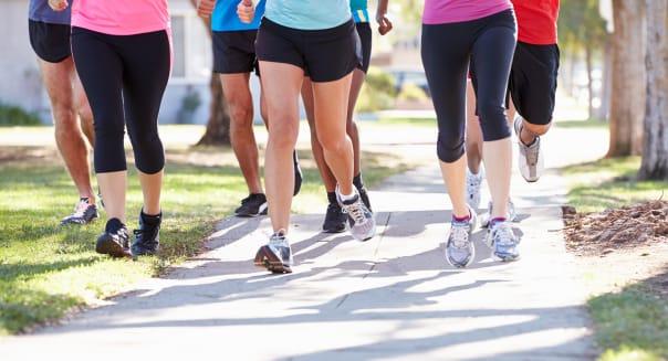 Close Up Of Runners Feet On Suburban Street