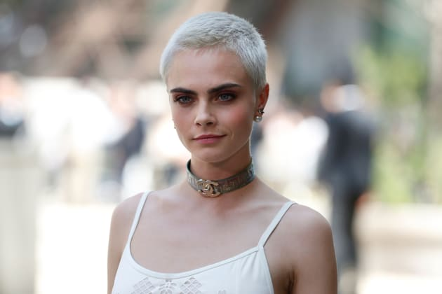 Cara Delevingne poses during the photocall before Chanel 2017-2018 fall/winter Haute Couture collection...