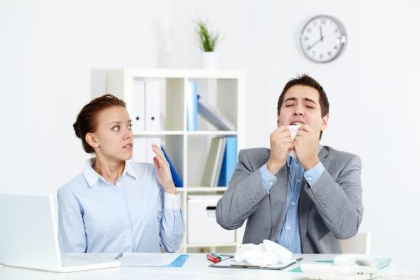 image of businessman sneezing...