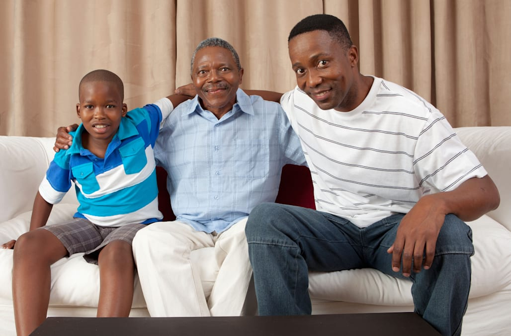 Three generations of men on the couch, Johannesburg, South Africa