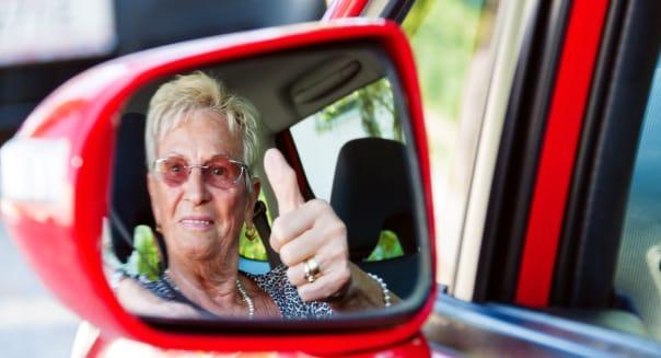 older woman wearing a seatbelt...