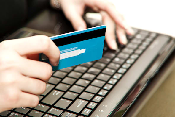 hands entering credit card...
